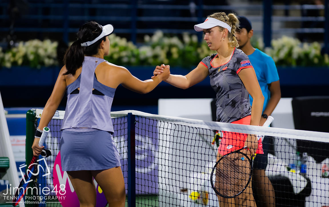 Lin Zhu of China & Elise Mertens of Belgium at the net after their first round match at the 2019 Dubai Duty Free Tennis Championships WTA Premier 5 tennis tournament
