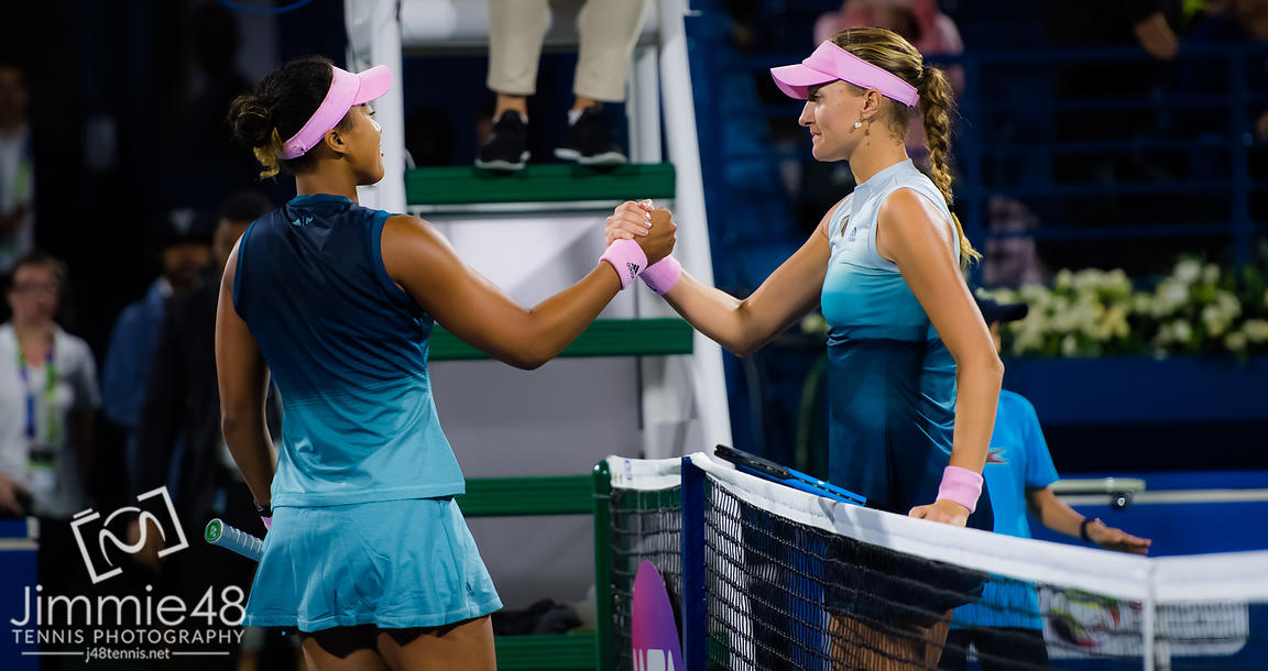 Naomi Osaka of Japan & Kristina Mladenovic of France at the net after their second-round match at the 2019 Dubai Duty Free Tennis Championships WTA Premier 5 tennis tournament