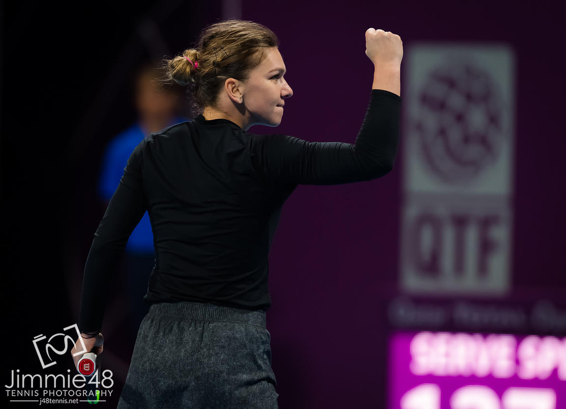 Simona Halep of Romania celebrates winning her quarter-final match at the 2019 Qatar Total Open WTA Premier tennis tournament