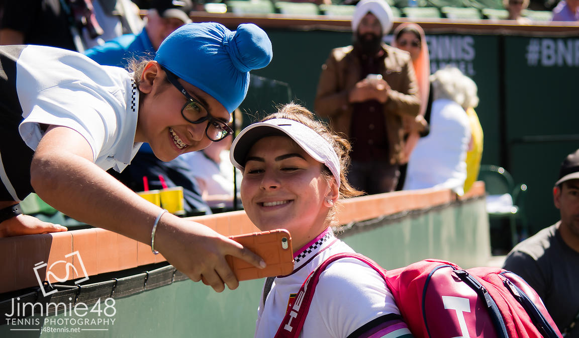 Bianca Andreescu of Canada signs autographs after her quarter-final match at the 2019 BNP Paribas Open WTA Premier Mandatory tennis tournament