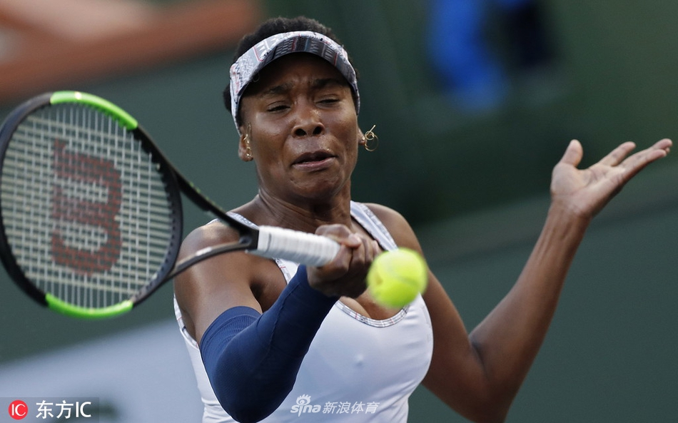 epa07432707 Venus Williams of United States in action against Mona Barthel of Germany during the BNP Paribas Open tennis tournament at the Indian Wells Tennis Garden in Indian Wells, California, USA, 12 March 2019. The men's and women's final will be played, 17 March 2019.  EPA/JOHN G MABANGLO