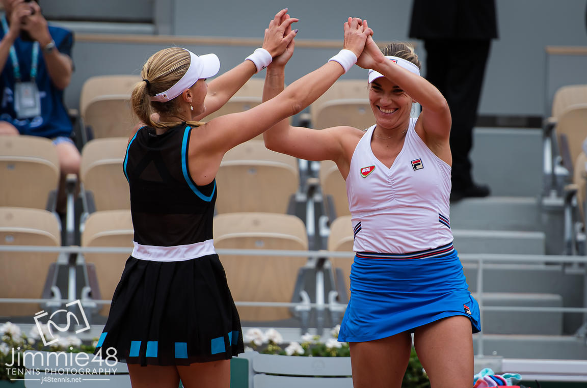 Timea Babos of Hungary & Kristina Mladenovic of France celebrate winning the doubles title of the 2019 Roland Garros Grand Slam tennis tournament