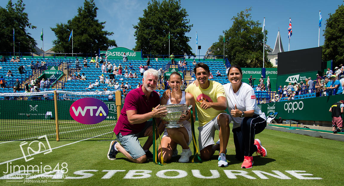 Karolina Pliskova of the Czech Republic and her team pose with the winners trophy at the 2019 Nature Valley International WTA Premier tennis tournament