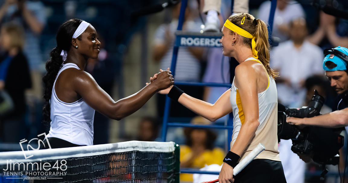 Sloane Stephens of the United States & Marie Bouzkova of the Czech Republic at the net after their first-round match at the 2019 Rogers Cup WTA Premier Tennis 5 Tournament