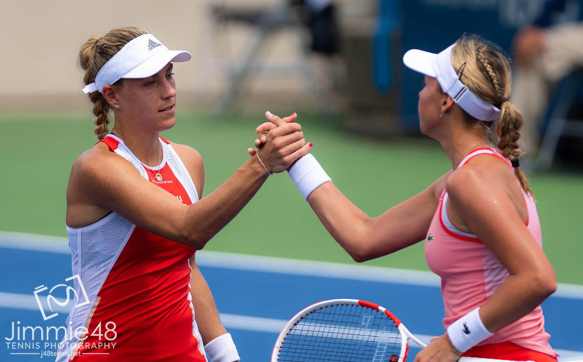 Angelique Kerber of Germany & Anett Kontaveit of Estonia at the net after their first-round match at the 2019 Western & Southern Open WTA Premier Tennis 5 Tournament