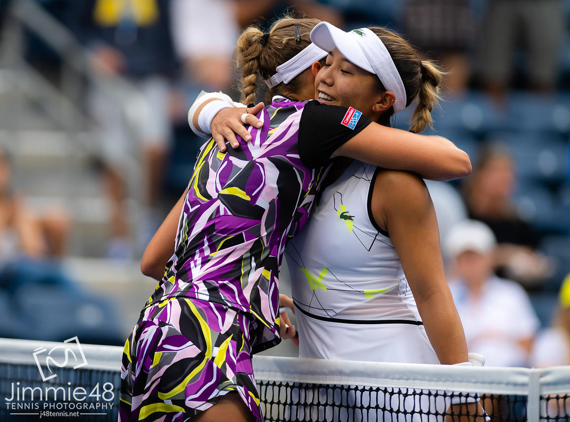 Elise Mertens of Belgium & Krisie Ahn of the United States at the net after their fourth-round match at the 2019 US Open Grand Slam tennis tournament