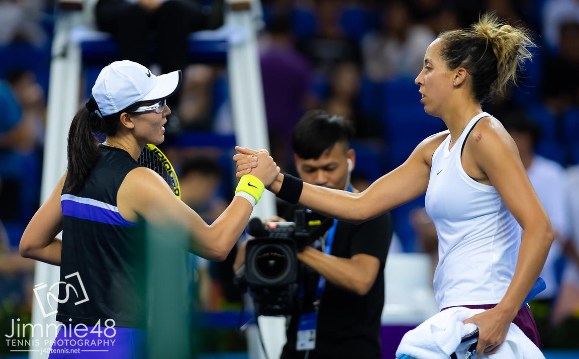 Saisai Zheng of China &  Madison Keys of the United States at the net after their RR1 match at the 2019 WTA Elite Trophy tennis tournament