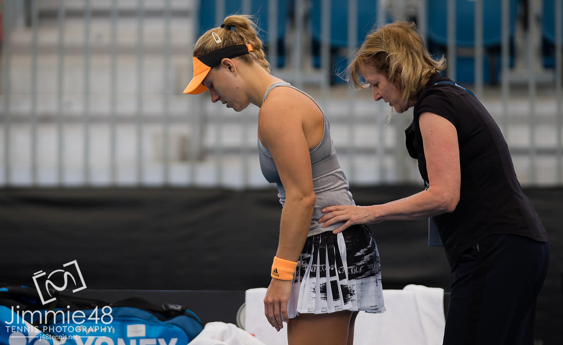 Angelique Kerber of Germany is forced to retire with injury from her second round match at the 2020 Adelaide International WTA Premier tennis tournament