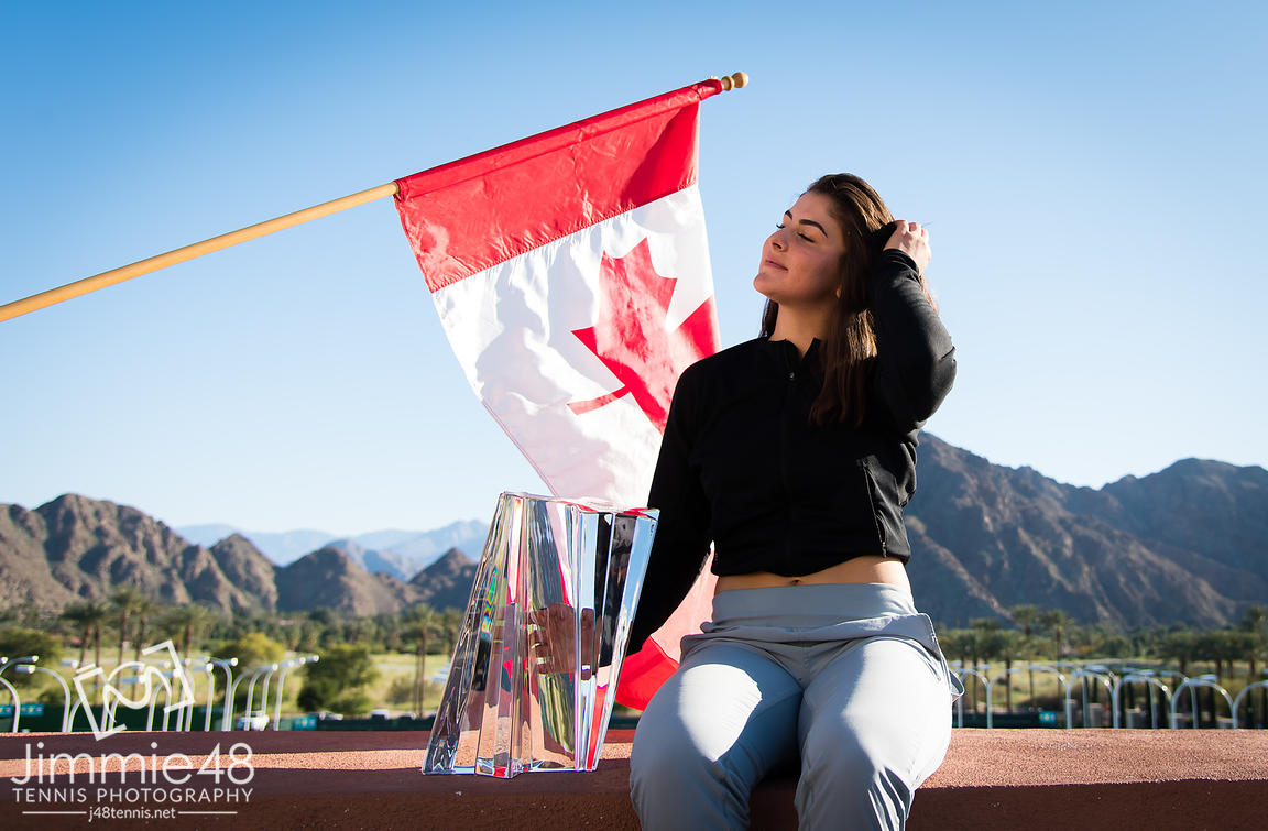 Bianca Andreescu of Canada poses with her trophy during a photo shoot after winning the final of the 2019 BNP Paribas Open WTA Premier Mandatory tennis tournament