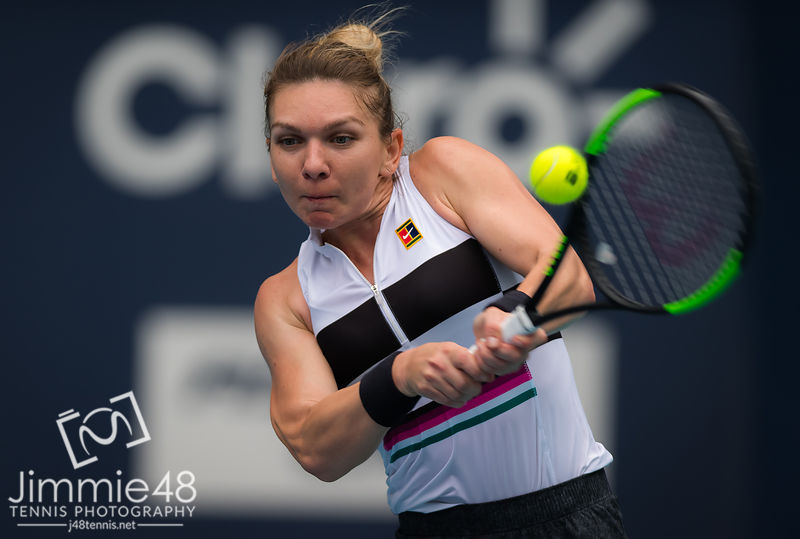 Polana Hercog of Slovenia & Simona Halep of Romania in action during her third-round match at the 2019 Miami Open WTA Premier Mandatory tennis tournament