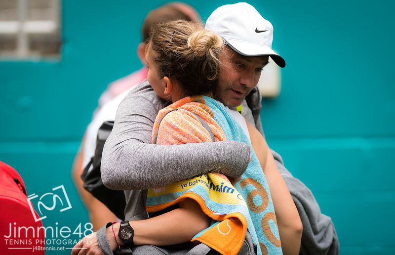 Simona Halep of Romania hugs coach Daniel Dobre after winning her third-round match at the 2019 Miami Open WTA Premier Mandatory tennis tournament