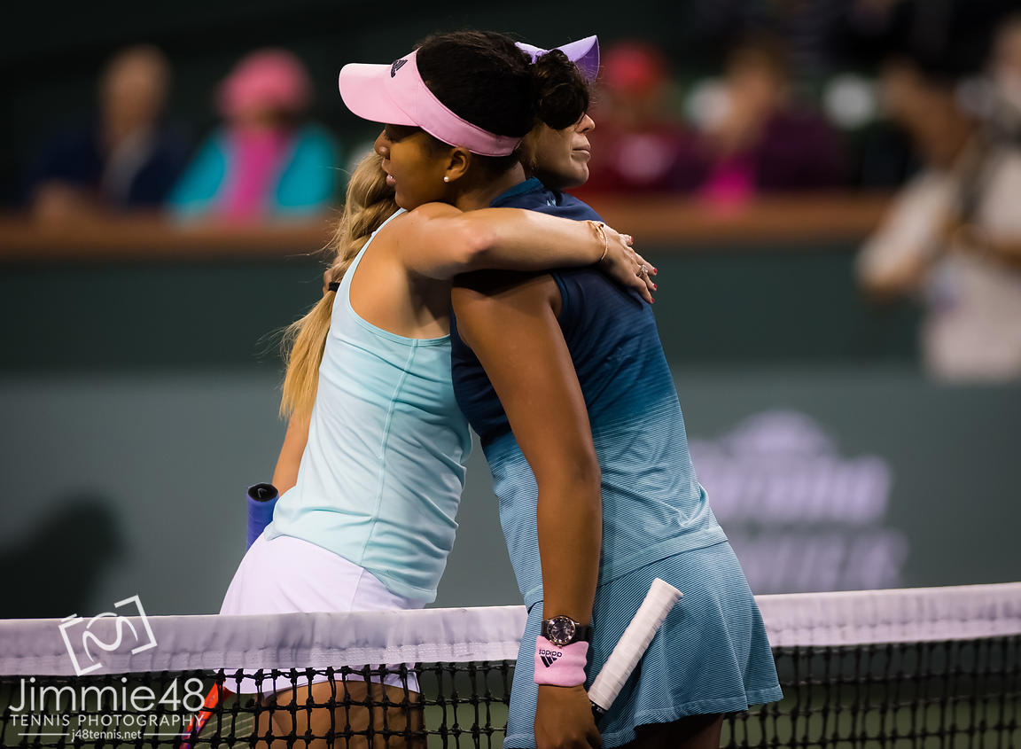 Danielle Collins of the United States & Naomi Osaka of Japan at the net after their third-round match at the 2019 BNP Paribas Open WTA Premier Mandatory tennis tournament