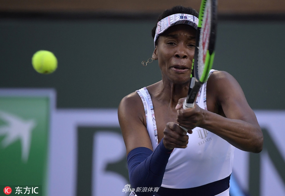 Venus Williams returns a shot to Mona Barthel, of Germany, at the BNP Paribas Open tennis tournament Tuesday, March 12, 2019 in Indian Wells, Calif. (AP Photo/Mark J. Terrill)