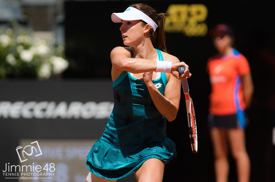 Alize Cornet of France in action during her first-round match at the 2019 Internazionali BNL d'Italia WTA Premier 5 tennis tournament