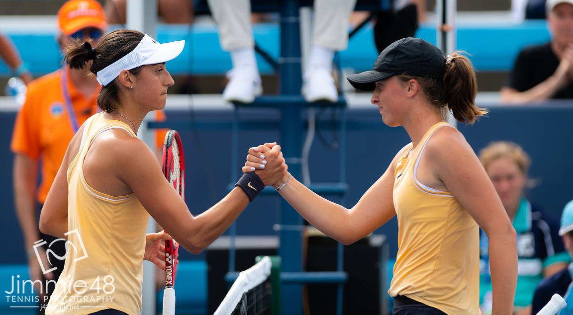 Caroline Garcia of France & Iga Swiatek of Poland at the net after their first-round match at the 2019 Western & Southern Open WTA Premier Tennis 5 Tournament