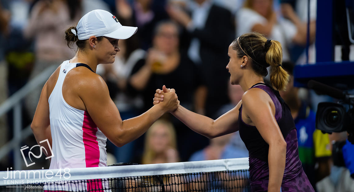 Ashleigh Barty of Australia & Lauren Davis of the United States at the net after their second-round match at the 2019 US Open Grand Slam tennis tournament