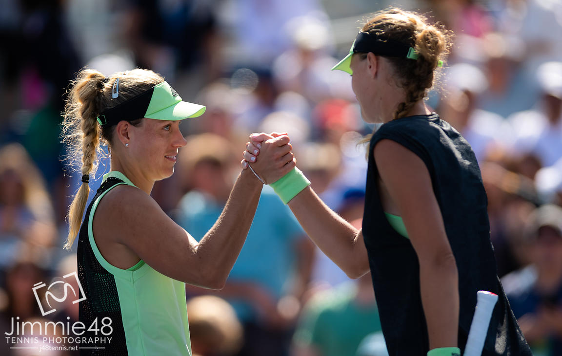 Angelique Kerber of Germany & Kristina Mladenovic of France at the net after the first round of the 2019 US Open Grand Slam tennis tournament