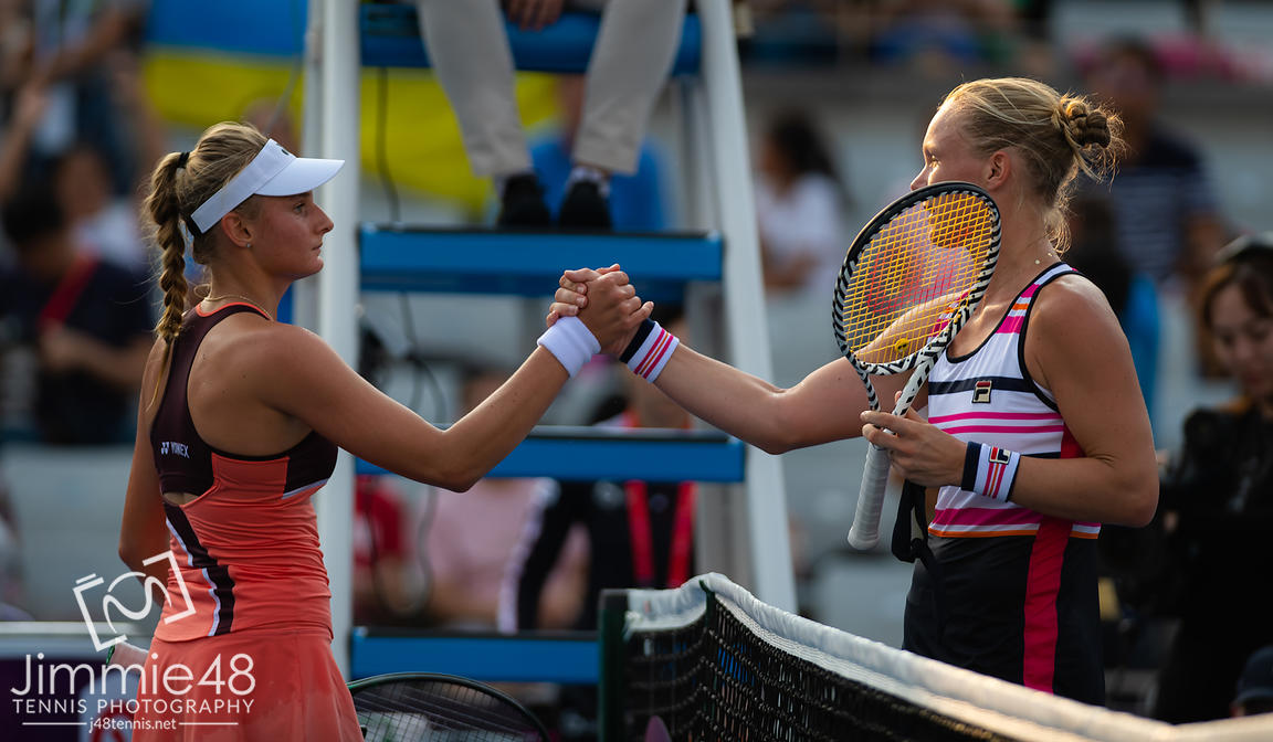 Dayana Yastremska of the Ukraine & Kiki Bertens of the Netherlands at the net after their second-round match at the 2019 China Open Premier Mandatory tennis tournament