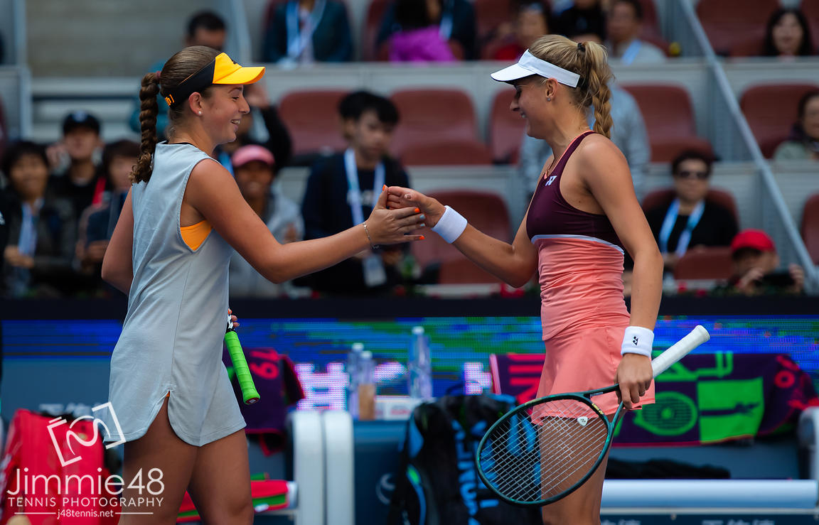 Jelena Ostapenko of Latvia & Dayana Yastremska of the Ukraine playing doubles at the 2019 China Open Premier Mandatory tennis tournament