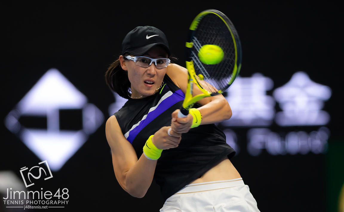 Saisai Zheng of China in action during her second-round match at the 2019 China Open Premier Mandatory tennis tournament
