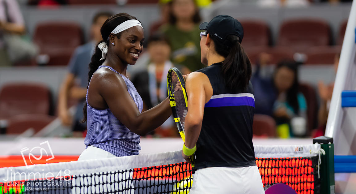 Sloane Stephens of the United States & Saisai Zheng of China at the net after their second-round match at the 2019 China Open Premier Mandatory tennis tournament