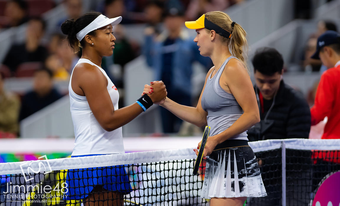 Naomi Osaka of Japan & Caroline Wozniacki of Denmark at the net after their semi-final match at the 2019 China Open Premier Mandatory tennis tournament