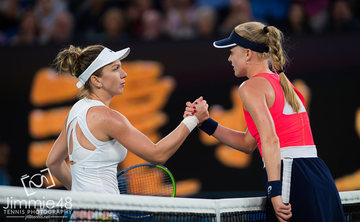 Simona Halep of Romania & Harriet Dart of Great Britain at the net after their second round match at the 2020 Australian Open Grand Slam tennis tournament