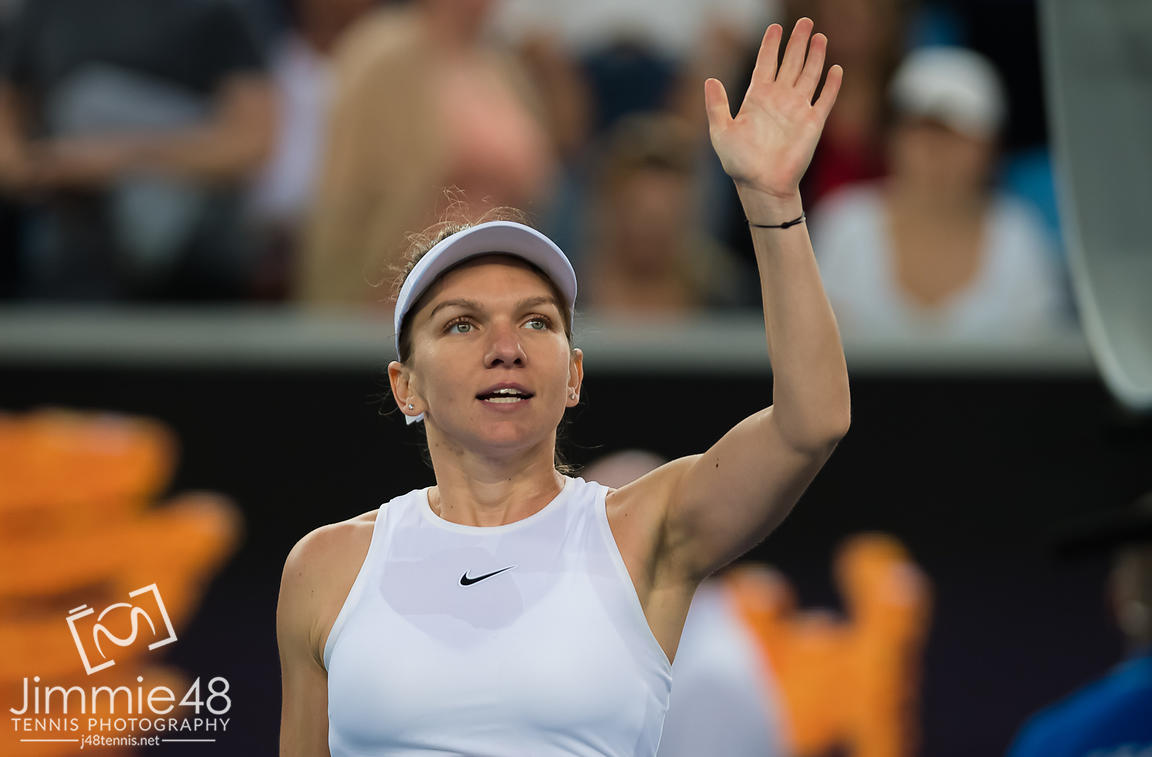 Simona Halep of Romania in action during her first round match at the 2020 Australian Open Grand Slam tennis tournament